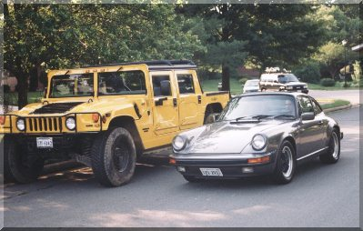 my 911 next to a Hummer